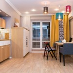 1-bucatarie open space cu livingul amenajata in stil nordic cu loc de luat masa mare