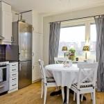 1-bucatarie si loc de luat masa apartament 3 camere 80 mp