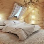 1-dormitor amenajat in mansarda cu peretii si tavanul placati cu lemn
