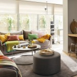 1-living cu loc de luat masa pereti gri si multe accente cromatice