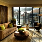 10-decor living modern amenajat in nuante de maro cu accente cromatice vernil