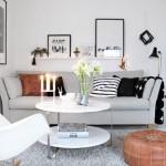 10-zona de conversatie living dotata cu o canapea un fotoliu balansoar si un puf
