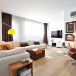 11-accente galbene si portocalii in amenajarea unui living modern cu note maro