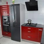 11-combina frigorifica si cuptoare electrice de culoare neagra