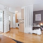 11-dormitor separat cu perdele de living si bucatarie open space apartament modern mic