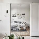 11-vedere din living in dormitorul matrimonial apartament scandinav finisat in alb