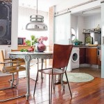 12-bucatarie cu mobila pe colt ascunsa in spatele unor usi glisante din sticla alba