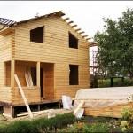 13-casa cu parter si etaj construita din popi de lemn imbinati in sistem lego