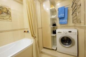 15-masina de spalat integrata in noua baie a apartamentului de 42 mp complet renovat