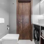 15-masina de spalat neagra integrata in baie