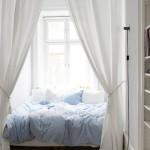 16-un dormitor rustic rudimentar decorat in alb cu textile bleu