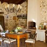 17-bucatarie de vara cu loc de luat masa amenajate in terasa casei din piatra