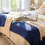 2-combinatie cuverturi crem si albastru pat dormitor amenajat in stil maritim