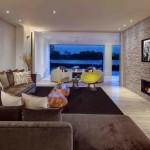 2-living modern cu perete de accent finisat cu piatra decorativa gri