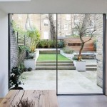 2-perete din sticla si luminator tavan living modern apartament Notting Hill Londra