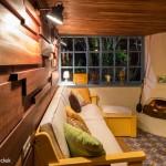 4-canapea in fata semineului amenajare garaj rezidential Brasov by Marius Teicu