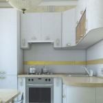 4-exemplu design bucatarie moderna pe colt in alb crem si auriu