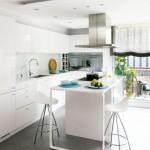 4-insula de bucatarie cu plita integrata amenajare open space alb si modern