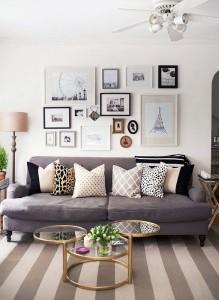4-peretele de deasupra canapelei din living decorat cu tablouri si fotografii inramate
