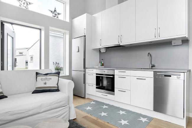 5-living si bucatarie open space casuta compacta moderna de 19 mp