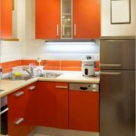 5-mobila portocalie forma L bucatarie moderna