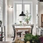 5-vedere spre locul de luat masa din bucataria open space apartament amenajat in stil scandinav