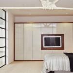 6-dressing modern cu usi fara manere si televizor integrat in centru
