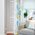 6-fotoliu confortabil asezat sub fereastra livingului redecorat