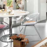 7-loc de luat masa cu masa rotunda si scaune din policarbonat transparent
