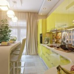 8-bucatarie moderna cu mobila galbena si blat crem