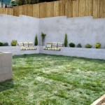 8-dupa renovare curtea casei amenajata cu gazon gard nou si banci din beton