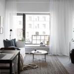 8-living scandinav simplu cu textile si mini galerie cu tablouri