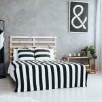 8-perete de accent din beton slefuit in amenajare dormitor modern