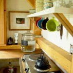 8-plita electrica bucatarie casam ica din lemn construita in copacii din padure