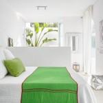 9-dormitor modern minimalist alb cu accente decorative maure si accente cromatice verzi