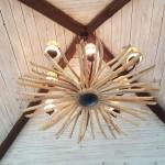 9-lustra rustica realizata din crengi uscate de lemn