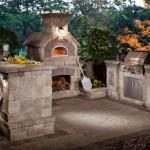 bucatarie de vara exterioara cu gratar cuptor si bar din piatra naturala