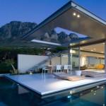 casa ultra moderna inconjurata de o piscina