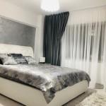 dormitor apartament amenajat modern pat matrimonial