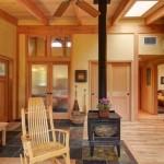 godin fier in mijlocul open space casa mica lemn