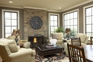 living clasic accente rustice ceas supradimensionat decor perete piatra naturala