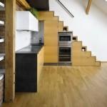 mobila bucatarie integrata in golul de sub scara interioara casa moderna design industrial